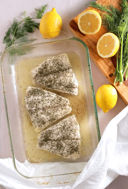 White fish steamed with lemon and dill for fish that is easy, juicy and flavorful! Paleo, low-carb, ketogenic, gluten-free