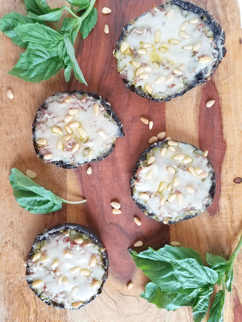 These stuffed Portobello Mushroom Pizzas with pesto and prosciutto are so delicious! They're also low-carb, ketogenic-friendly, grain-free, gluten-free, egg-free, tomato- and nightshade-free and easy to make in just 30 minutes.