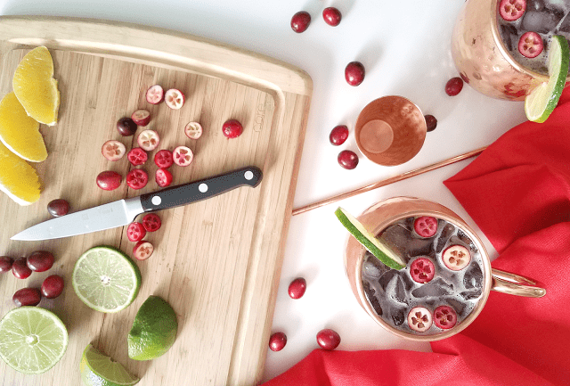 This Cranberry Citrus Morgan Mule is perfect for your holiday party or an evening in fuzzy socks! The combination of cranberry juice with ginger and spices is a perfectly festive flavor combination, yet this cocktail will help you make healthier choices this holiday season since it has less than half the sugar of most mule cocktails. Cheers to that!