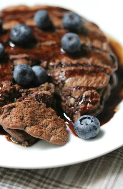 Chocolate Zucchini Pancakes with Blueberries by Strength and Sunshine