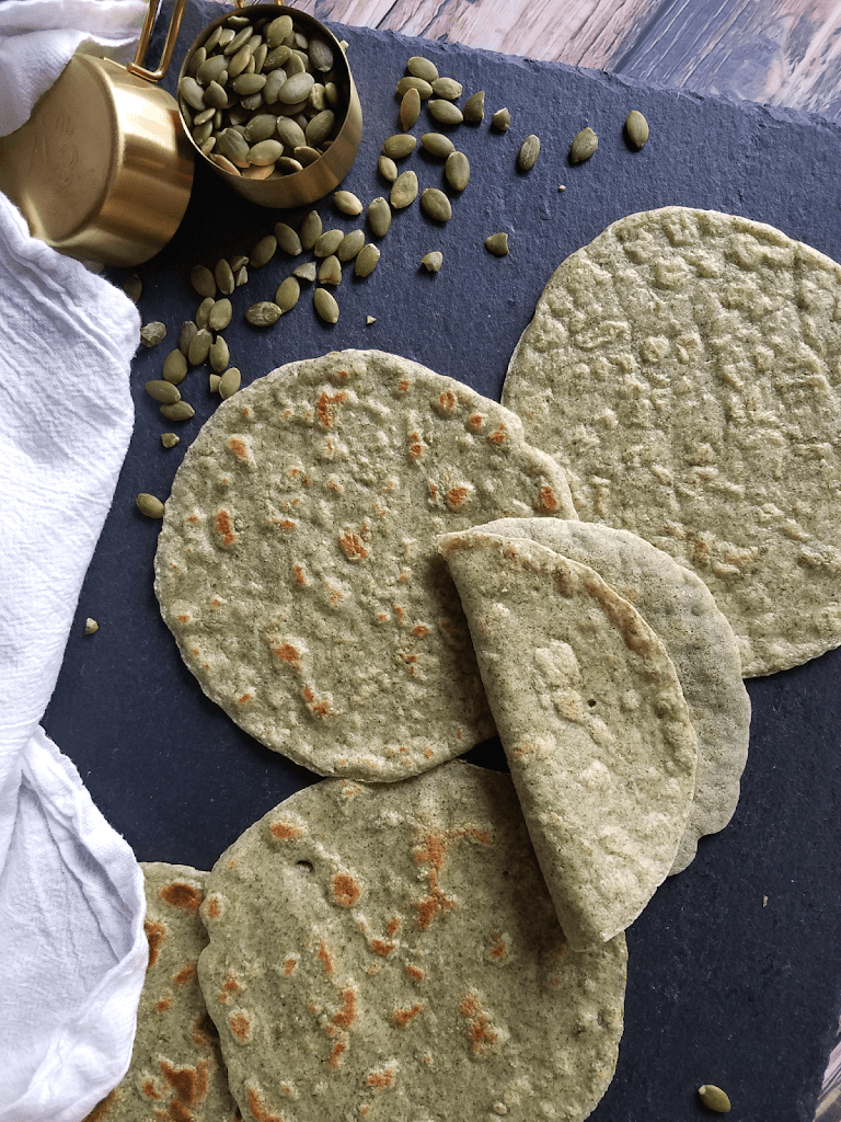 These Pumpkin Seed (Pepita) Tortillas are just as pliable, nutritious and delicious as my original gluten-free tortillas / wraps, but ground pumpkin seeds instead of almond flour makes them nut-free as well as gluten-free, grain-free, vegan, Paleo and Whole30 compliant. They're also easy to make and only require four ingredients. Time to conquer taco night!